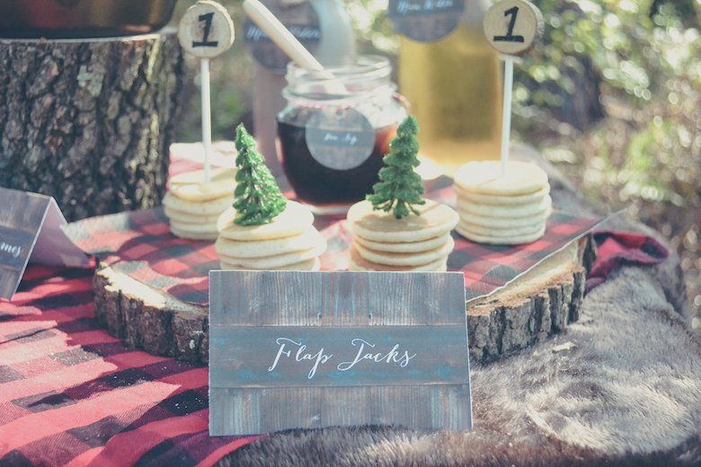 I love the themed food and beverages...the little faux wood signs add the perfect touch!