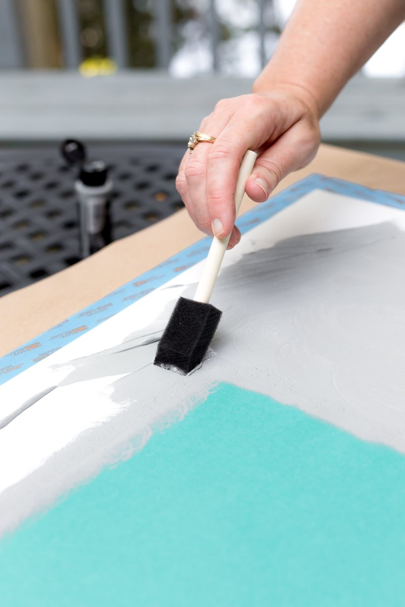 use foam brush to apply paint around the edges of the cardstock