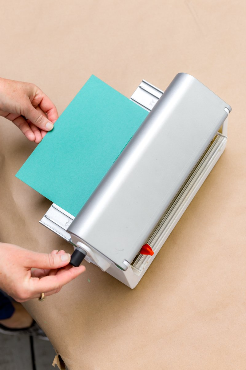 cut cardstock to desired size and apply repositionable/temporary adhesive