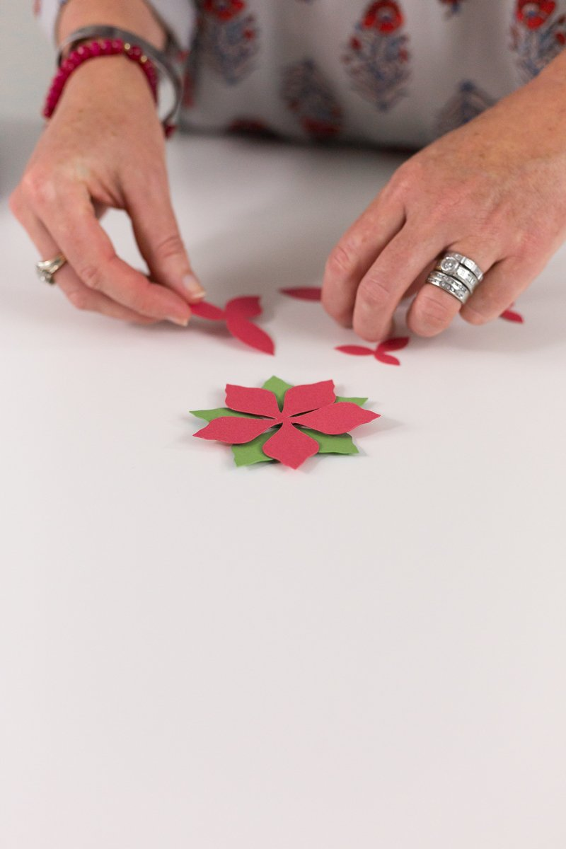 remove pieces from mat and assemble poinsettia