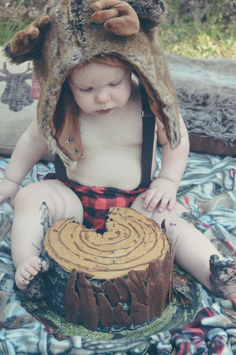 Fawn Over Baby outdoor lumberjack birthday baby boy eating cake