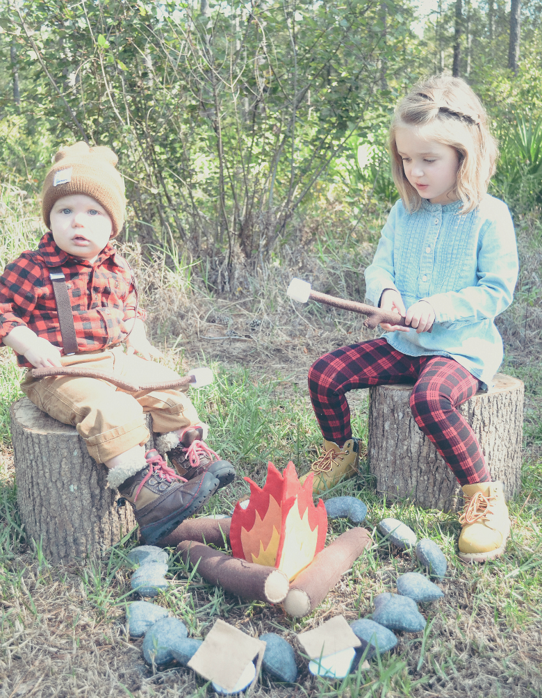 Fawn Over Baby outdoor lumberjack birthday party baby boy and young girl