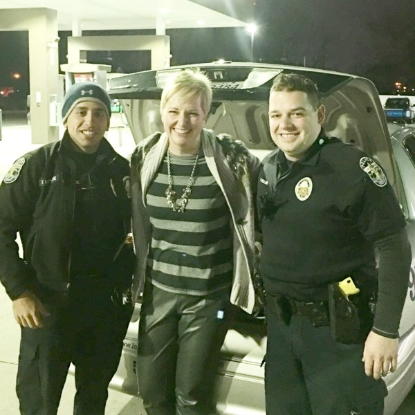 Woman smiling with cops