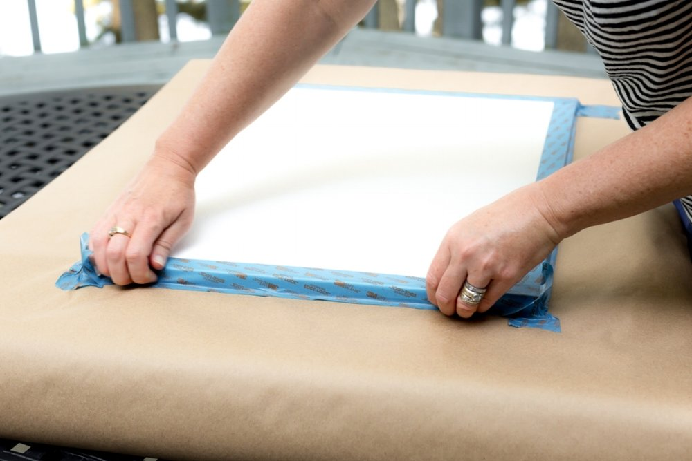 tape around edges of the canvas for custom baby wall decor