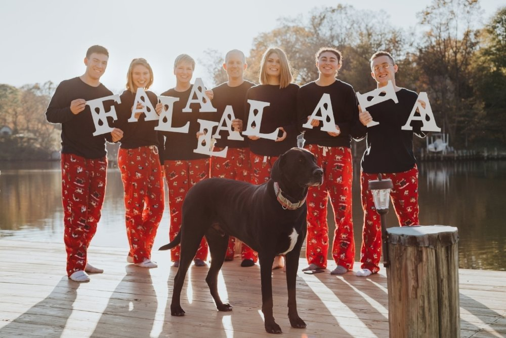 Christmas group photo with photo props and black dog