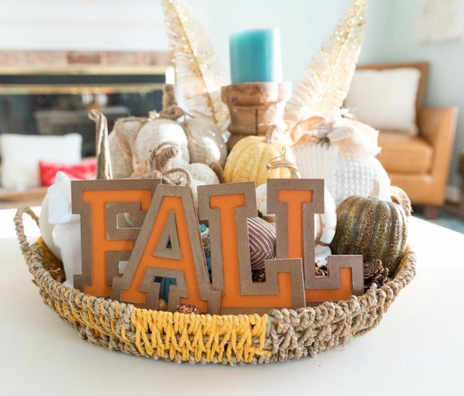 fall decor lettering and pumpkins sitting on table