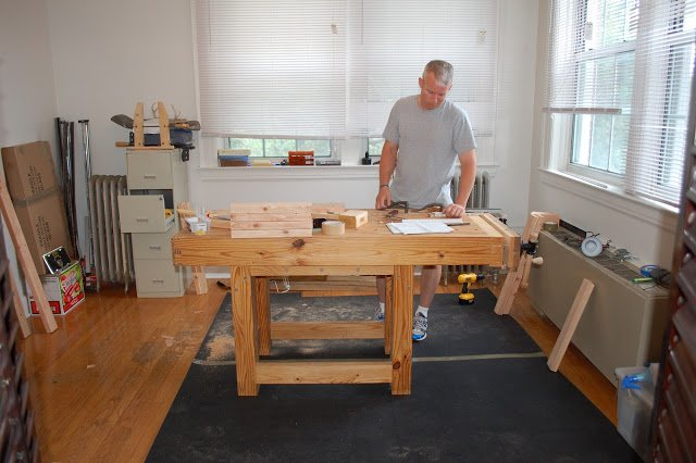 man doing woodworking at desk