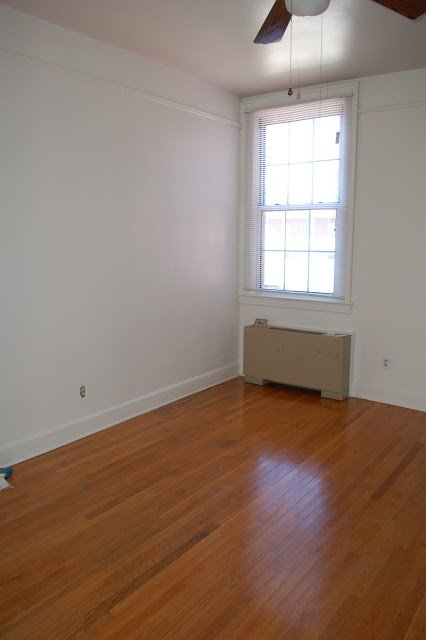 empty bright studio with wood floor