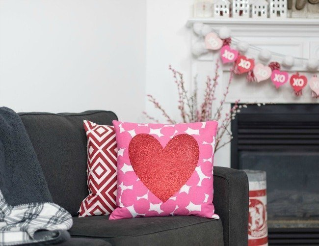 Valentine's Day pillow on grey couch