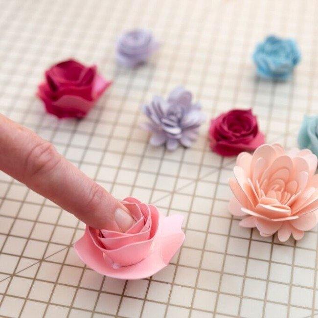 press paper flower into the center of paper