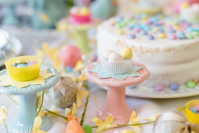 candy and white cake on bright spring Easter table