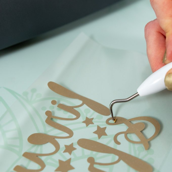 Cricut weeder to remove excess iron-on