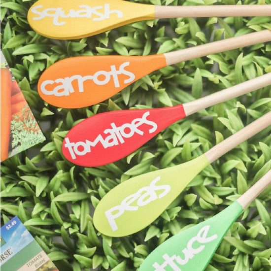 wooden spoon plant markers in grass