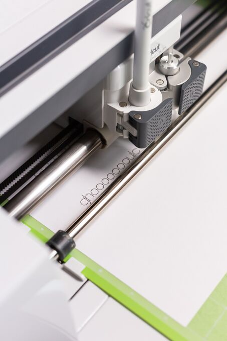 place your Cricut pen into your machine and close the clamp