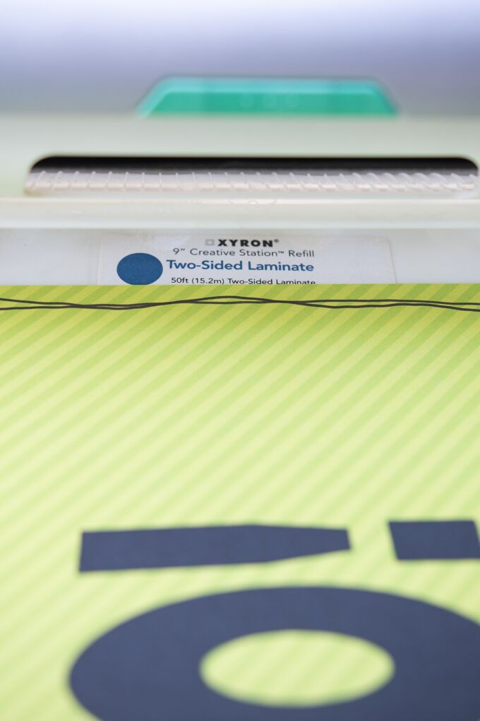 run the placemat through your Xyron 9'' Creative Station, using a Two-Sided Laminate Cartridge